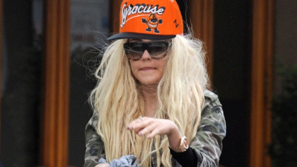 This is a (clearly) Photoshopped picture of former actress Amanda Bynes wearing a Syracuse Orange hat.